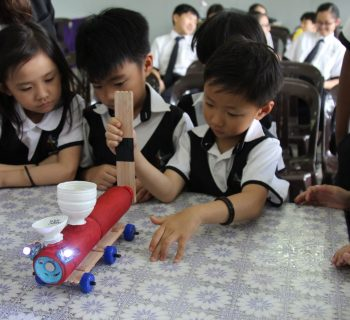International School KL students playing with science experiment kit